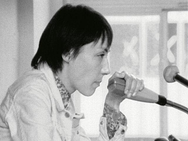 Helke Sander hält ihre Rede auf der 23. SDS-Delegiertenkonferenz in Frankfurt/Main am 13.9.1968 Quelle: Filmstill aus SWR-Report, September 1968